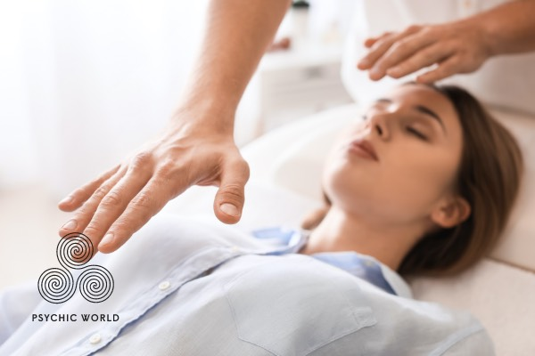 reiki reading on a woman laying down relaxing