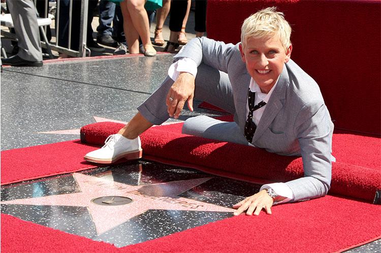 Ellen DeGeneres next to her Hollywood star ...