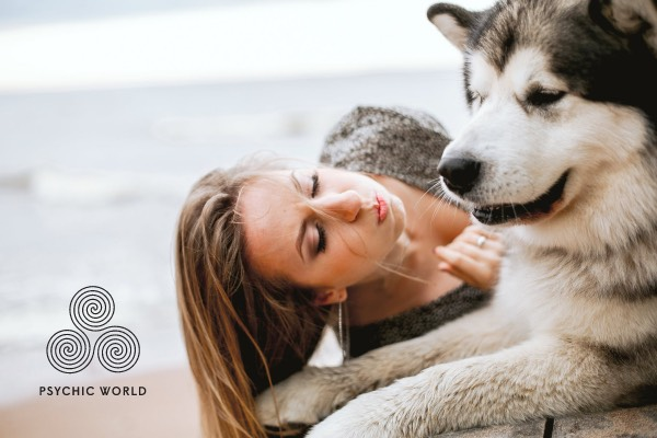 woman kissing the husky outside