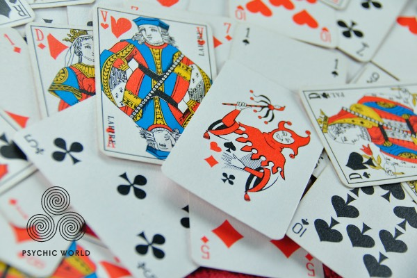 standard 52 card deck scattered everywhere