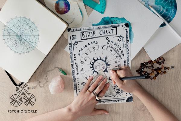 woman drawing circle astrology chart