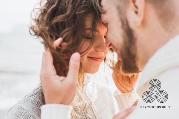 man touching woman hair outside