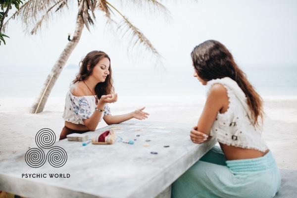 woman symbolon card reading on the beach