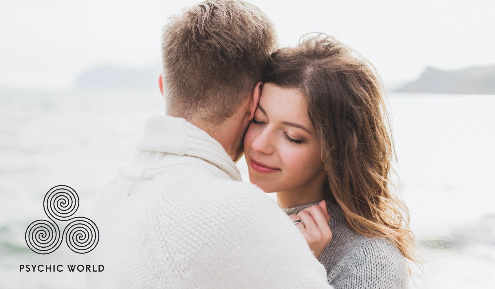woman hugging a man near the sea
