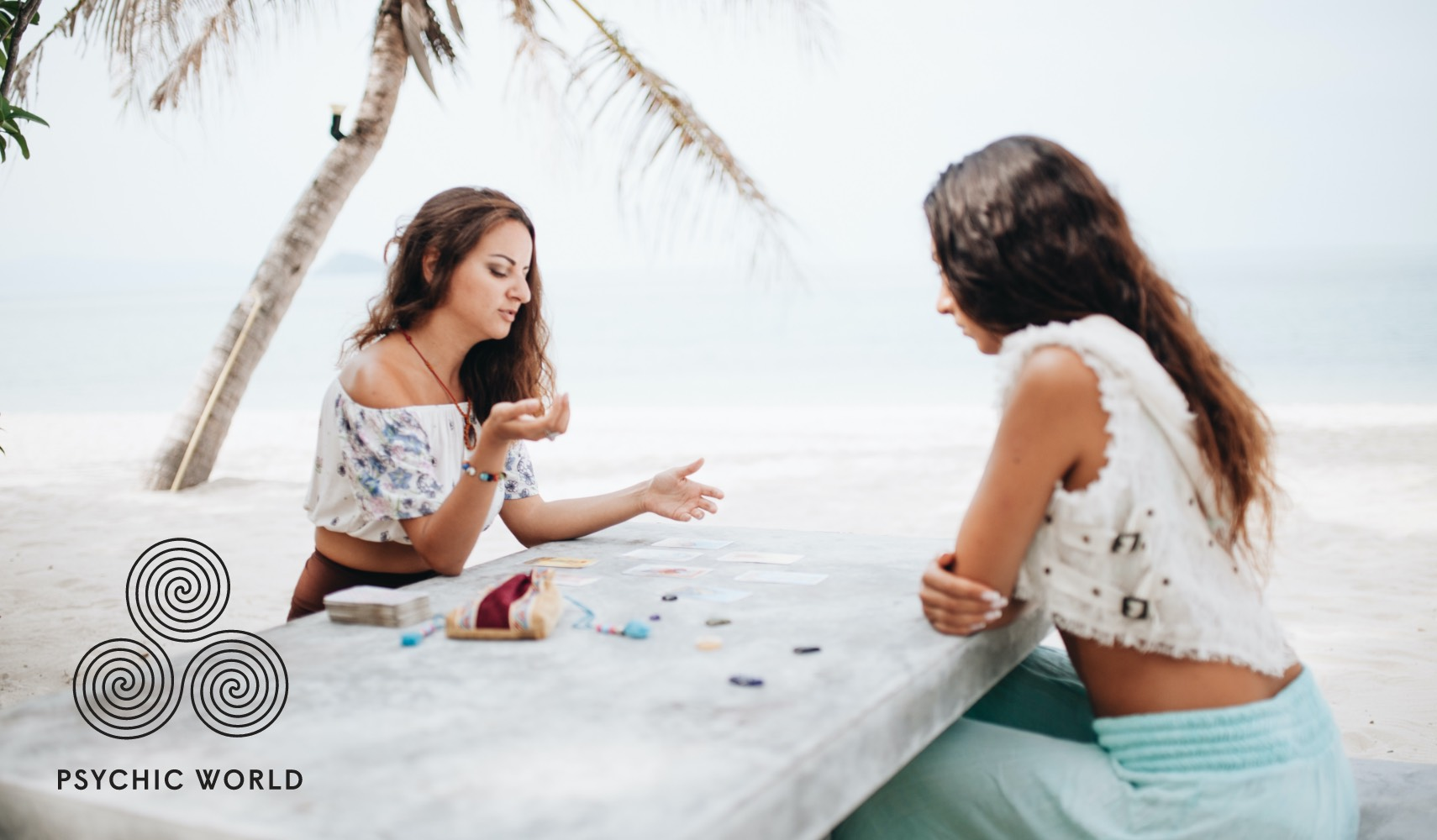 women angel card reading outside on the beach