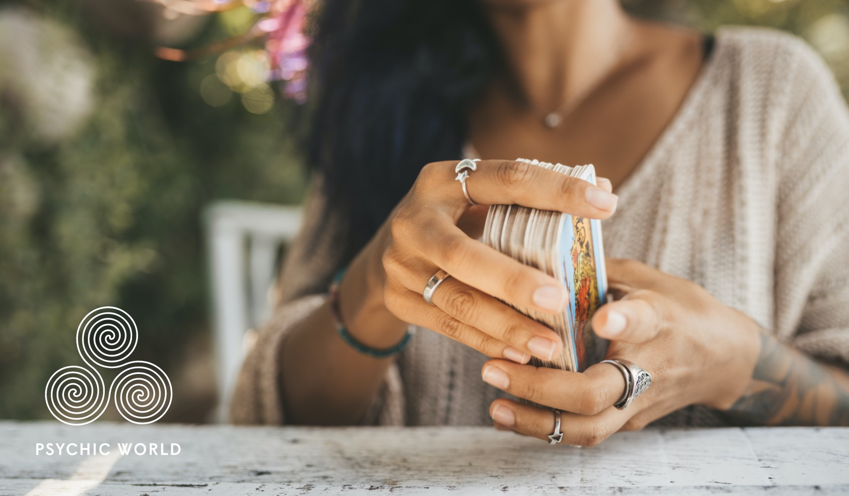 woman shuffling tarot cards outside